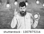 teacher in eyeglasses holds... | Shutterstock . vector #1307875216