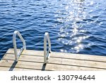 Dock And Ladder On Calm Summer...