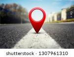 red gps pin on asphalt highway... | Shutterstock . vector #1307961310