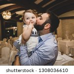 young happy dad kissing... | Shutterstock . vector #1308036610