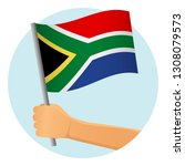 south africa flag in hand.... | Shutterstock .eps vector #1308079573