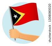 east timor flag in hand.... | Shutterstock .eps vector #1308080020