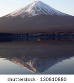 mountain Fuji and reflection on lake Kawaguchi, Japan - stock photo