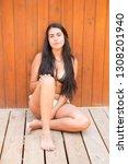 beautiful young girl posing in... | Shutterstock . vector #1308201940