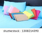 colorful folded duvet on fitted ... | Shutterstock . vector #1308214390