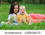 beautiful young mother and... | Shutterstock . vector #130828670