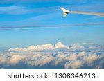 aircraft wing under blue sky in ... | Shutterstock . vector #1308346213