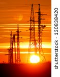 transmission towers with sunset | Shutterstock . vector #130838420