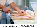 looking at cutting fish | Shutterstock . vector #1308448609