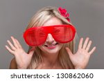 woman in crazy clown glasses on ... | Shutterstock . vector #130862060