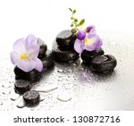 spa stones and purple flower ... | Shutterstock . vector #130872716