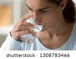 close up sick young woman holds ... | Shutterstock . vector #1308783466