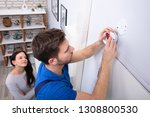 happy woman standing near... | Shutterstock . vector #1308800530