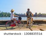 tourist couple cycling in... | Shutterstock . vector #1308835516