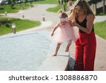 young mother with daughter at... | Shutterstock . vector #1308886870
