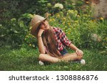 beautiful young cowgirl with... | Shutterstock . vector #1308886876
