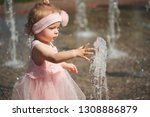 little girl plays with water in ... | Shutterstock . vector #1308886879