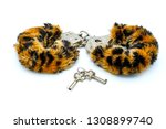 fur handcuffs on white... | Shutterstock . vector #1308899740
