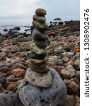 balancing stone at the beach | Shutterstock . vector #1308902476