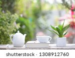 white coffee cup and kettle... | Shutterstock . vector #1308912760