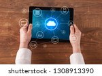 hand touching tablet with cloud ...   Shutterstock . vector #1308913390
