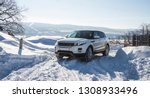 white range rover evoque with a ... | Shutterstock . vector #1308933496