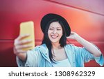 Happy Asian Girl Taking Selfie...