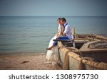 wedding couple in a boat on the ... | Shutterstock . vector #1308975730