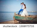 wedding couple in a boat on the ... | Shutterstock . vector #1308975733