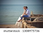 wedding couple in a boat on the ... | Shutterstock . vector #1308975736