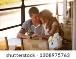 young couple in an open air cafe | Shutterstock . vector #1308975763