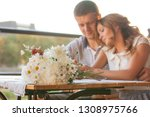young couple in an open air cafe | Shutterstock . vector #1308975766
