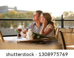 young couple in an open air cafe | Shutterstock . vector #1308975769