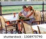 young couple in an open air cafe | Shutterstock . vector #1308975790