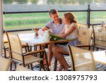 young couple in an open air cafe | Shutterstock . vector #1308975793