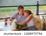 young couple in an open air cafe | Shutterstock . vector #1308975796