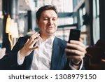 attractive young businessman... | Shutterstock . vector #1308979150