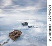 Rocks In A Blue Ocean Waves...