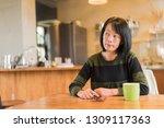 asian mature woman using... | Shutterstock . vector #1309117363