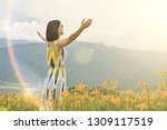 asian woman feel free and stand ... | Shutterstock . vector #1309117519