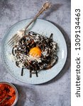 black pasta with red pesto and... | Shutterstock . vector #1309134463