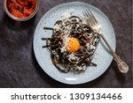 black pasta with red pesto and... | Shutterstock . vector #1309134466