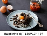 black pasta with red pesto and... | Shutterstock . vector #1309134469