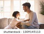 playful little daughter playing ... | Shutterstock . vector #1309145113