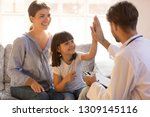Small photo of Happy cute child girl giving high five to male pediatrician welcoming little patient with mom at consultation, trusting kid and doctor celebrate good checkup medical results or getting cured healed