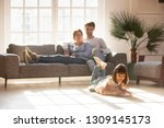 happy parents relaxing on couch ... | Shutterstock . vector #1309145173