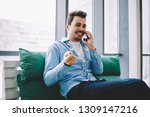 happy smiling male calling to... | Shutterstock . vector #1309147216
