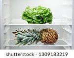 lettuce and pineapple on shelf... | Shutterstock . vector #1309183219
