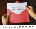 an open red envelope with a... | Shutterstock . vector #1309211920