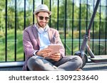 picture of smiling man using... | Shutterstock . vector #1309233640